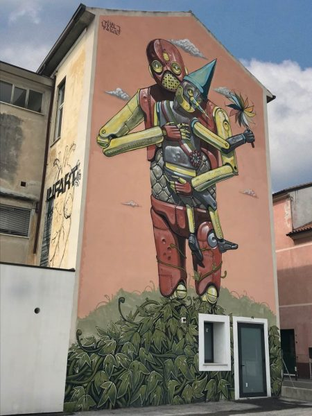 Graffito di infart artista a Bassano del Grappa vicino al parcheggio Le Piazze